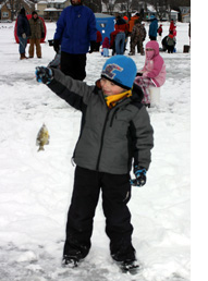Another child with their first fish on Monona Bay.